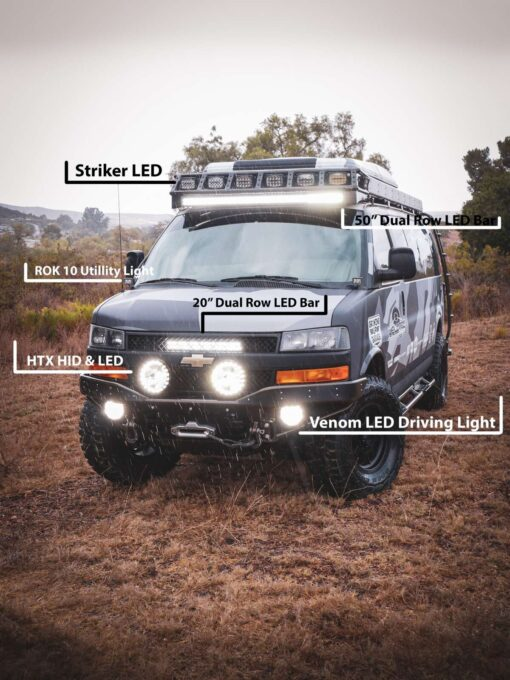 Chevy Express 4×4 van in rain with lightforce light on